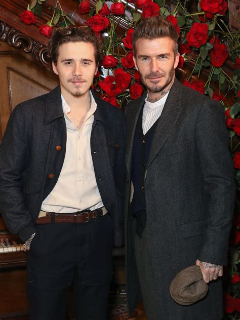 Brooklyn Beckham looks seriously unimpressed with David in