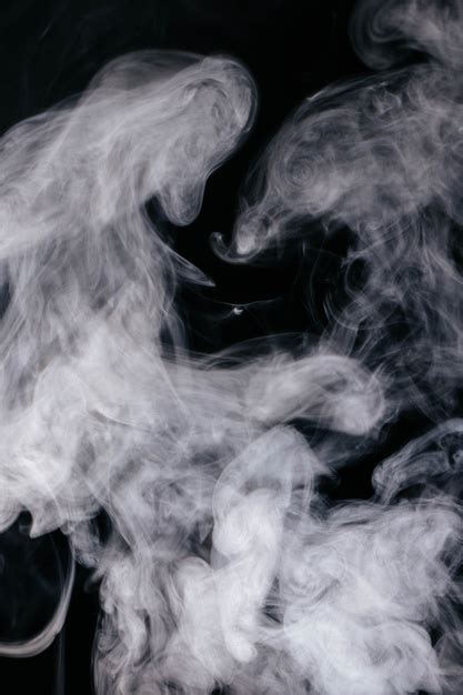 Grey smoke waves on black background Photo | Free Download