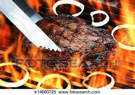 Stock Image of Juicy Steak on Flaming Grill k14680725