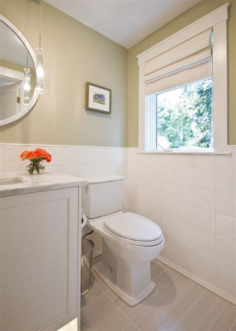 Guest Bathroom With Taupe Walls and White Tile Backsplash